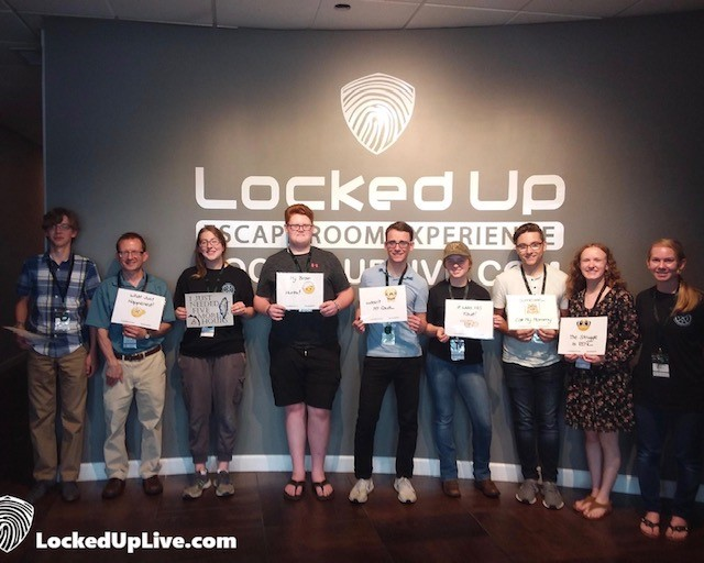 Students from Veritas Theology Insitute pose for a photo after successfully completing Locked Up escape room.